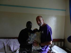 Caroline (Caretaker), Carlos (Baby), and me (enjoying holding a baby)