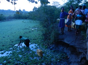 Fetching wash water with the children at the orphanage in Uganda...