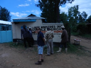 Greg presenting the clean water outlet for the community to the village Chief and Elders