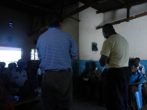 Greg and Pastor Moses giving a message to the Teso Pastor Trainees