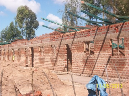Roof trusses ready to be raided in place on the walls