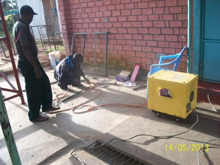 Welding the window and doors on-site for custom fit.