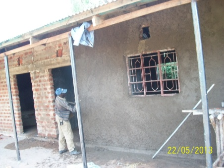Throwing the plaster (cement) up on the wall.  I've tried it...much harder than it looks.