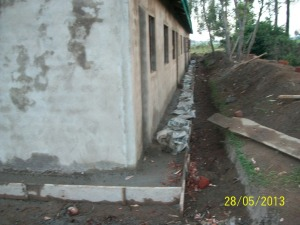 Concrete apron around the footer of the walls.