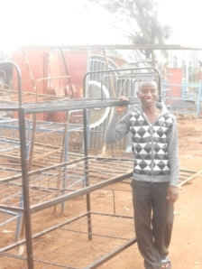 Triple decker steel bunk beds made in Jinja