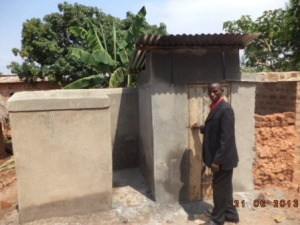Pastor at the new boys latrine and bath house