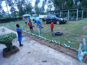 Randall and kids doing some home beautification projects.  Our 4x4 Isuzu is in the background.  I love it.
