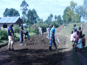 Greg leading a team to improve road drainage and eliminate mud near the orphanage.