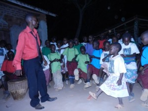 Pastor Paul and the kids dancing and singing worshipfully.  New shirts and handmade dresses.