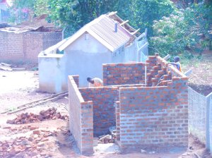 A new latrine/bath house is being finished as well.