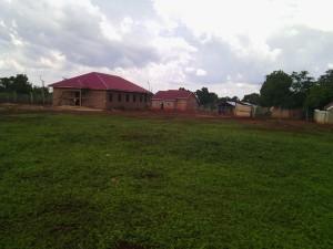 View from the back of the compound showing the Boys Dorm on the left with Girls House and other buildings to the right.