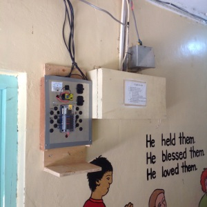 Completed installation of solar powered lighting in the boys dorm and cooking areas.  Moved the switch panel to a better location.