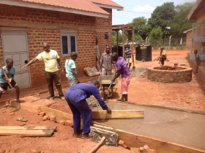 Here's Pastor Moses, who joined us from Kenya, teaching and directing the kids in the art of concrete work. We added walkways between the buildings.