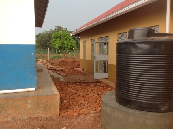Installed gutters and rain collection tanks on both sides of the Dining Hall as well as the boys dorm. Collecting water reduces mud and is used for cleaning. We also added concrete walkways between the buildings.